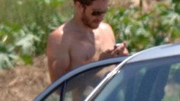 jake-shirtless-phone.jpg
