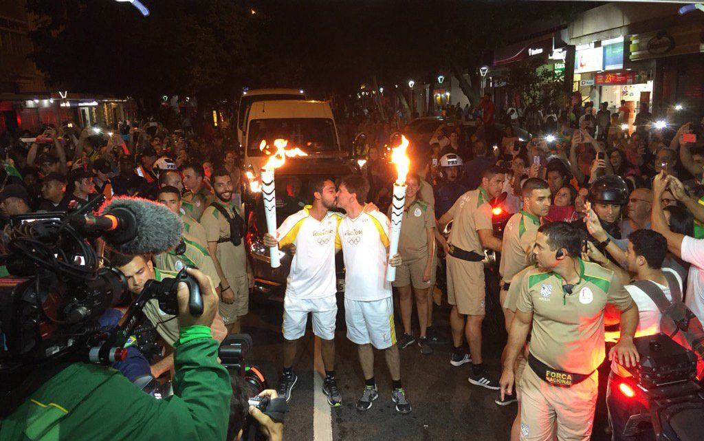 OMG, 2016 Olympic torch relay stops to have a big ole gay kiss