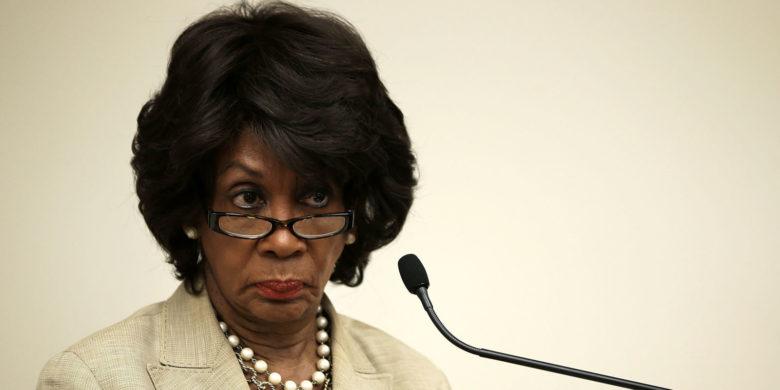 Maxine Waters stern look glasses